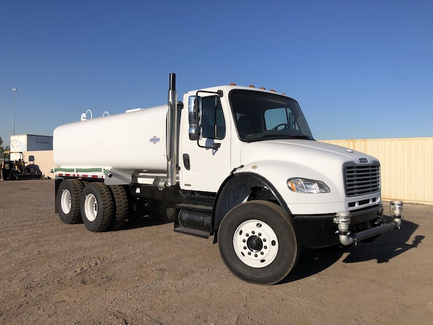 2009 Freightliner M2 106 4,250 Gallon Water Truck. Front passenger side view.