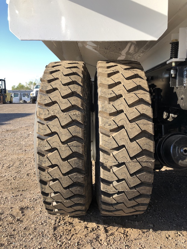 2009 Freightliner M2 106 4,250 Gallon Water Truck. Passenger sides second axle tires.