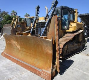 2012 CAT D6T XL. Front left view, cab blade and slope blade.