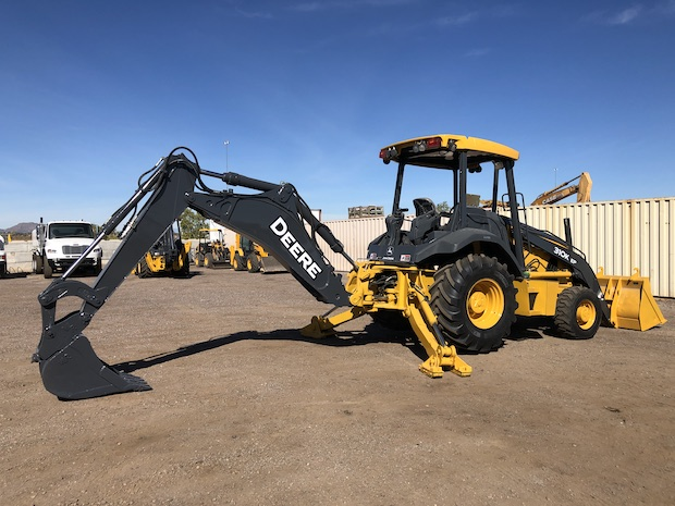 2013 John Deere 310K EP. Boom , stick, and support legs exteneded.