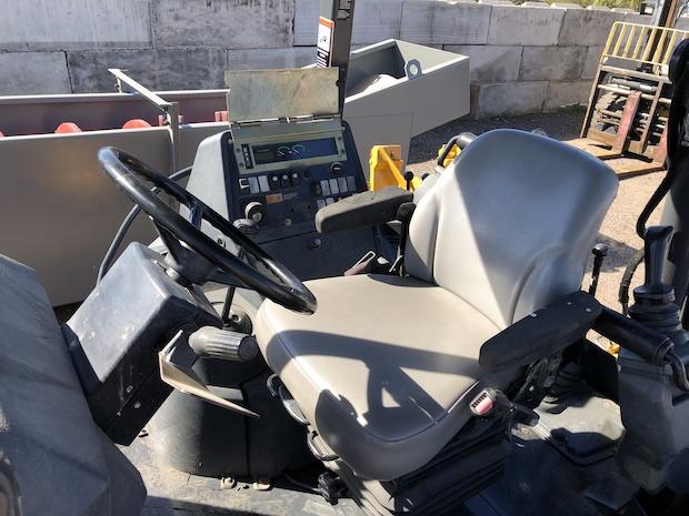 2013 John Deere 310K EP. OROPS, seat, steering wheel, and controls.
