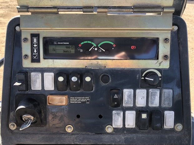 2013 John Deere 310K EP. Main control switches and hour meter.