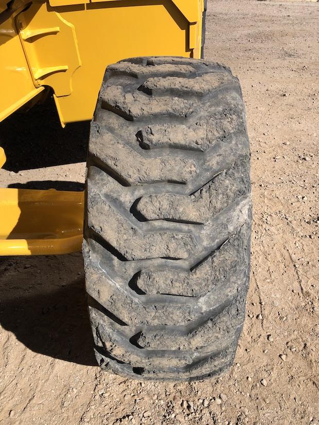 2013 John Deere 310K EP. Front drivers tire.