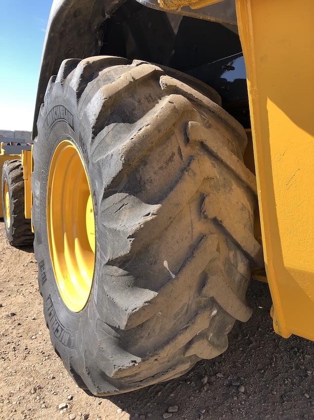 2013 John Deere 310K EP. Rear drivers tire.