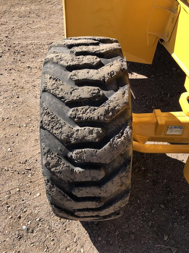 2013 John Deere 310K EP. Front passenger tire.