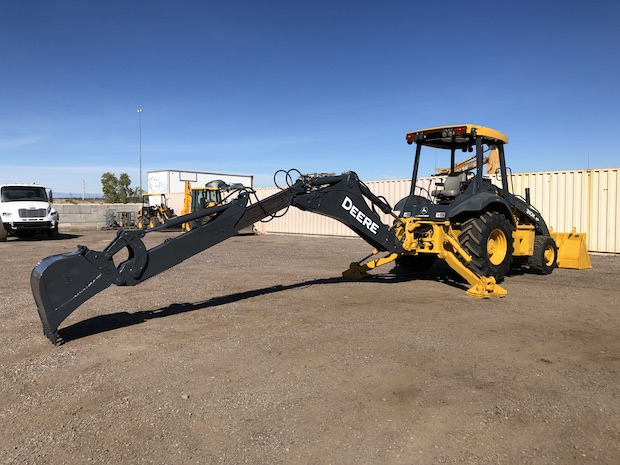 2013 John Deere 310K EP with Extend-a-hoe. Extend-a-hoe fully extended.