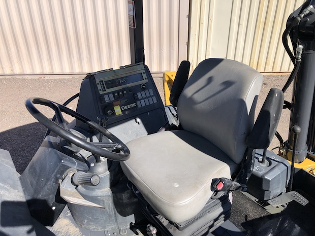 2013 John Deere 310K EP with Extend-a-hoe. OROPS. Seat, steering wheel, and controls.