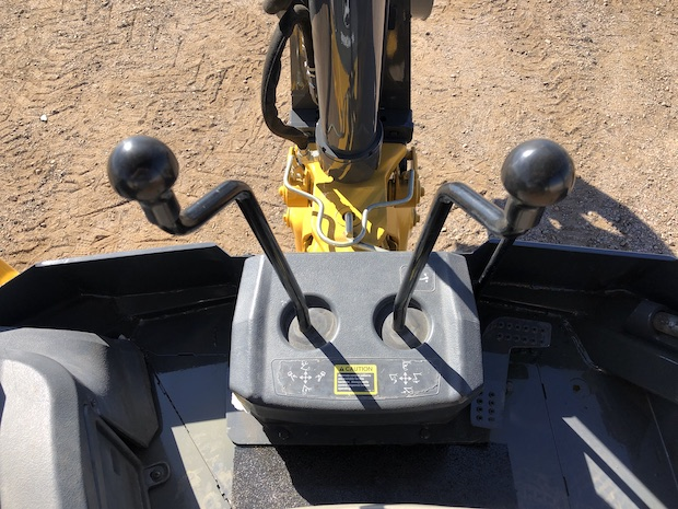 2013 John Deere 310K EP with Extend-a-hoe. Boom, stick, and bucket control levers.