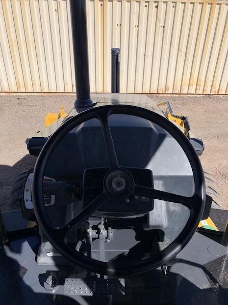 2013 John Deere 310K EP with Extend-a-hoe. Steering wheel.