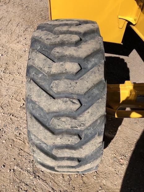 2013 John Deere 310K EP with Extend-a-hoe. Passenger side front tire.
