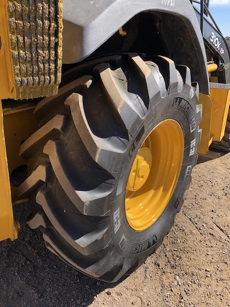 2013 John Deere 310K EP with Extend-a-hoe. Passenger side rear tire.