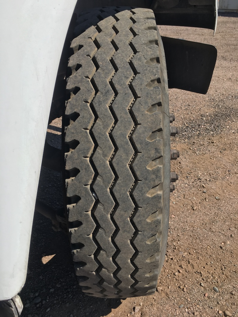 1999 Ford F800 Water Truck. Passenger side front tire.