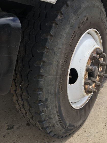 1999 Ford F800 Water Truck. Driver side front tire.