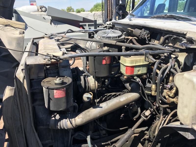 1999 Ford F800 Water Truck. Cummins 5.9L diesel engine.