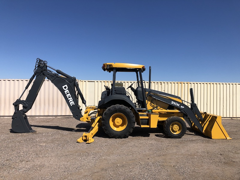 2012 John Deere 310K EP. Side view of bucket and support legs extended.