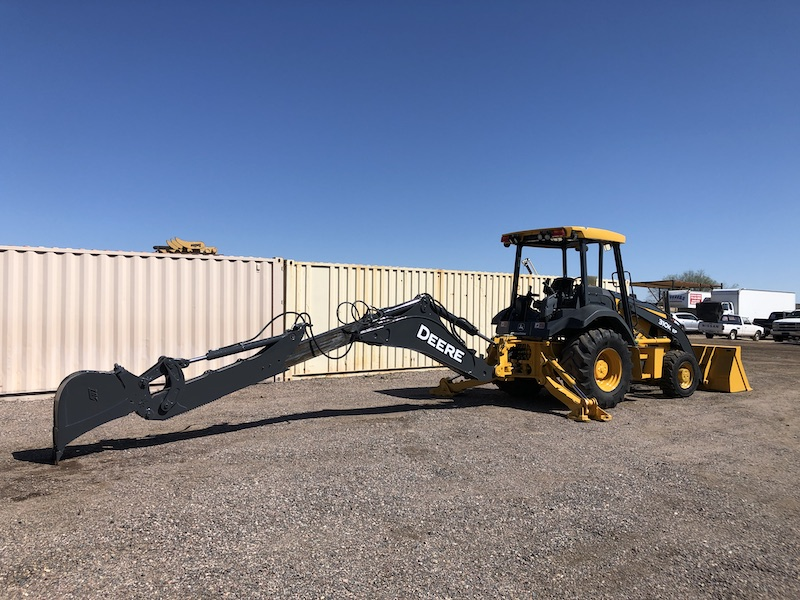 2012 John Deere 310K EP. Side view of bucket extend-a-hoe, and support legs extended.