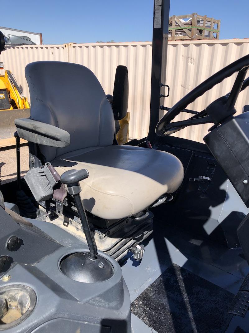 2012 John Deere 310K EP. Seat and cab view.
