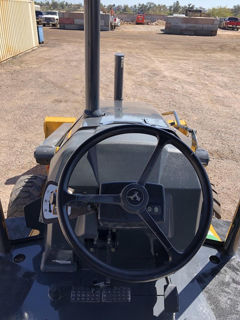 2012 John Deere 310K EP. Steering wheel and driving view.