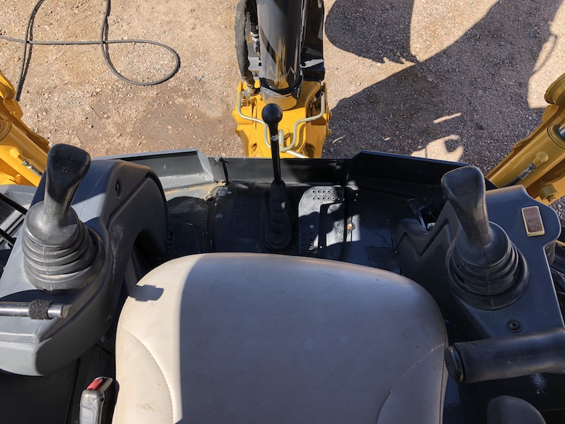 2012 John Deere 310K EP. Pilot controls, boom lock, and extend-a-hoe pedal.