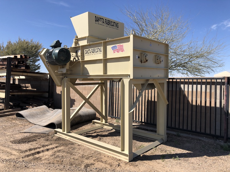 New Dakota Twin-Shaft Pugmill Mixer discharge view with support stand.