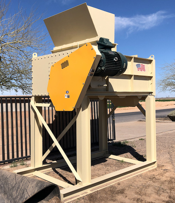 New Dakota Twin-Shaft Pugmill Mixer feed view with support stand.