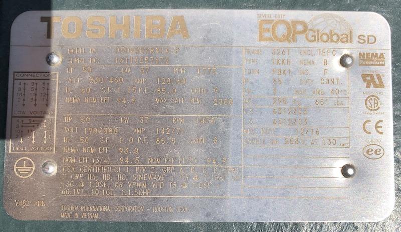 New Dakota Twin-Shaft Pugmill Mixer. Name plate of toshiba electric motor.