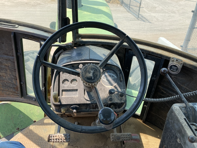 1979 John Deere 8440 Tractor. Inside of cab, steering wheel and dash.