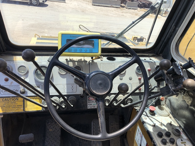 1981 Grove RT980. In cab controls and steering wheel.