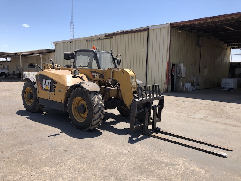 CAT TH407 Telehandler Forklift. Front right view.