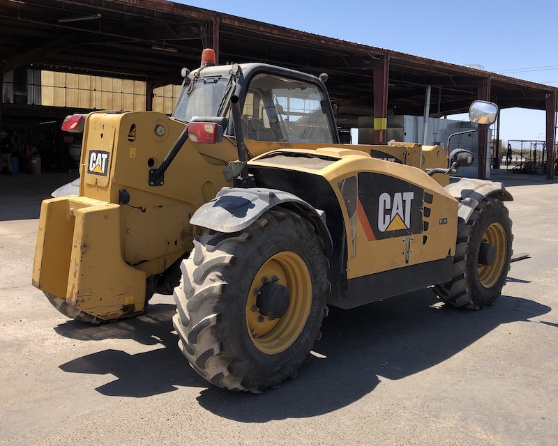 CAT TH407 Telehandler Forklift. Rear right view.