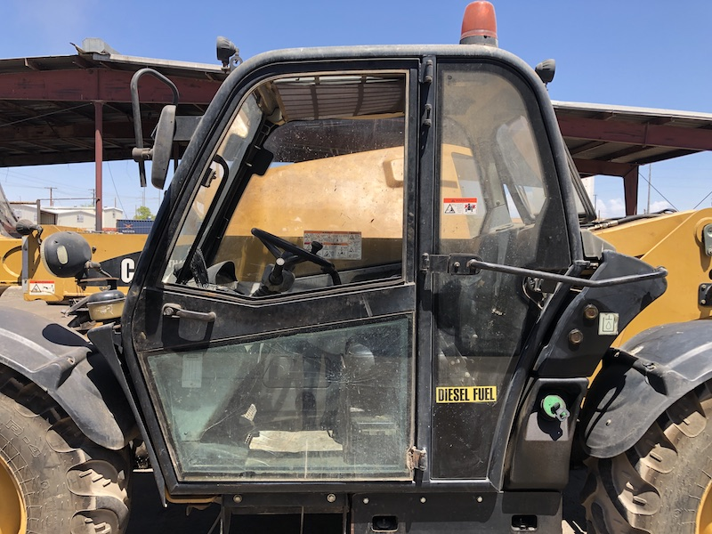 CAT TH407 Telehandler Forklift. Cab with door closed.