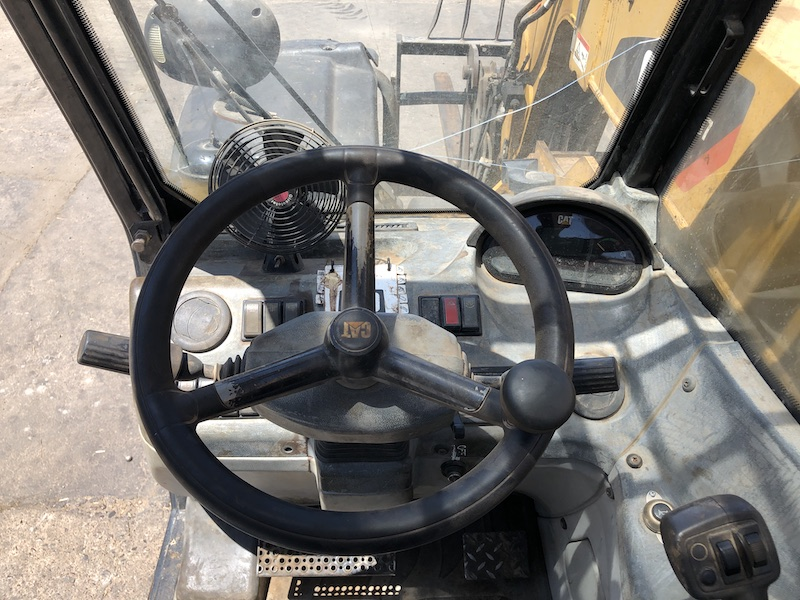 CAT TH407 Telehandler Forklift. Steering wheel and controls.
