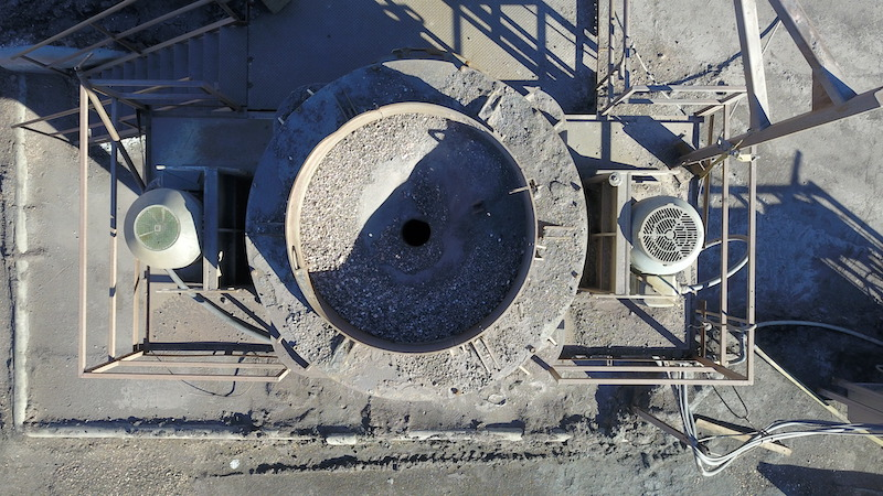 REMco 9000 SandMax Vertical Shaft Impact Crusher. Drone picture looking down on feed opening of VSI crusher.