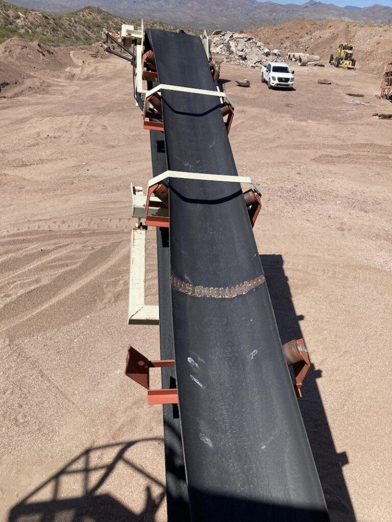 2004 Astec2612D Fold-N-Go Portable Screening Plant. Left side discharge conveyor.